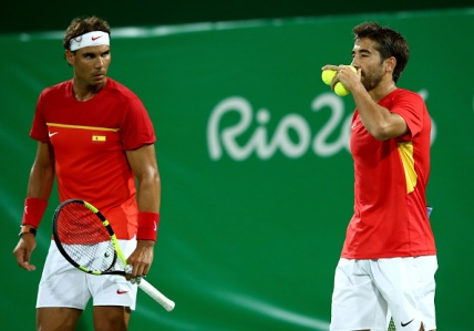 RIO DE JANEIRO, BRAZIL - AUGUST 07: Marc Lopez and Rafael Nadal of Spain in action against Robin Haase and Jean-Julien Rojer of Holland in their doubles match on Day 2 of the Rio 2016 Olympic Games at the Olympic Tennis Centre on August 7, 2016 in Rio de Janeiro, Brazil. (Photo by Cameron Spencer/Getty Images)