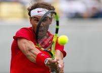 Spain's Rafael Nadal returns to France's Gilles Simon during the men's tennis competition at the 2016 Summer Olympics in Rio de Janeiro, Brazil, Thursday, Aug. 11, 2016. (AP Photo/Vadim Ghirda)