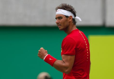 Spain's Rafael Nadal reacts after winning a point against France's Gilles Simon during the men's tennis competition at the 2016 Summer Olympics in Rio de Janeiro, Brazil, Thursday, Aug. 11, 2016. (AP Photo/Vadim Ghirda)