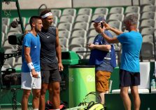 2016 Rio Olympics - Tennis - Training - Olympic Tennis Centre - Rio de Janeiro, Brazil - 05/08/2016. Rafael Nadal (ESP) of Spain poses for pictures with Damir Dzumhur (BIH) of Bosnia during a training session. REUTERS/Kevin Lamarque FOR EDITORIAL USE ONLY. NOT FOR SALE FOR MARKETING OR ADVERTISING CAMPAIGNS.