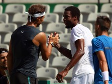 2016 Rio Olympics - Tennis - Training - Olympic Tennis Centre - Rio de Janeiro, Brazil - 05/08/2016. Rafael Nadal (ESP) of Spain shakes hands with Gael Monfils (FRA) of France after a training session. REUTERS/Kevin Lamarque FOR EDITORIAL USE ONLY. NOT FOR SALE FOR MARKETING OR ADVERTISING CAMPAIGNS.