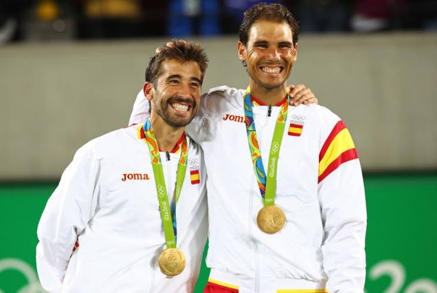 Gold medalists Marc Lopez and Rafael Nadal of Spain stand on the podium after the Men's Doubles competition on Day 7 of the Rio 2016 Olympic Games at the Olympic Tennis Centre on August 12, 2016 in Rio de Janeiro, Brazil. (Aug. 11, 2016 - Source: Clive Brunskill/Getty Images South America)