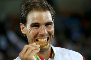 2016 Rio Olympics - Tennis - Victory Ceremony - Men's Doubles Victory Ceremony - Olympic Tennis Centre - Rio de Janeiro, Brazil - 12/08/2016. Rafael Nadal (ESP) of Spain poses with his gold medal that he won with Marc Lopez (ESP) of Spain. REUTERS/Kevin Lamarque FOR EDITORIAL USE ONLY. NOT FOR SALE FOR MARKETING OR ADVERTISING CAMPAIGNS.