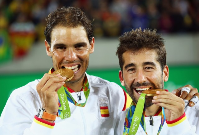 Gold medalists Rafael Nadal and Marc Lopez of Spain celebrate with their medals after the Men's Doubles Gold medal match against Horia Tecau and Florin Mergea of Romania on Day 7 of the Rio 2016 Olympic Games at the Olympic Tennis Centre on August 12, 2016 in Rio de Janeiro, Brazil. (Aug. 11, 2016 - Source: Clive Brunskill/Getty Images)