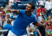 Rafael Nadal, of Spain, hits balls to fans after beating Denis Istomin, of Uzbekistan, during the first round of the U.S. Open tennis tournament, Monday, Aug. 29, 2016, in New York. (AP Photo/Alex Brandon)