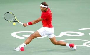 Rafael Nadal of Spain hits a return to Thomaz Bellucci of Brazil during their Rio 2016 Olympic Games Men's Singles match at the Olympic Tennis Centre in the Olympic Park in Rio de Janeiro, Brazil, 12 August 2016. (España, Brasil, Tenis) EFE/EPA/MICHAEL REYNOLDS