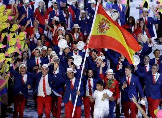 Rafael Nadal carries the Spanish flag at the opening ceremony of the Rio Olympic Games