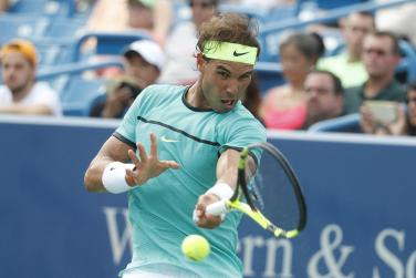 Rafael Nadal, of Spain, returns to Pablo Cuevas, of Uruguay, on the fifth day of the Western & Southern Open tennis tournament, Wednesday, Aug. 17, 2016, in Mason, Ohio. (AP Photo/John Minchillo)