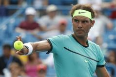 Rafael Nadal, of Spain, tosses a ball away during a match against Pablo Cuevas, of Uruguay, on the fifth day of the Western & Southern Open tennis tournament, Wednesday, Aug. 17, 2016, in Mason, Ohio. (AP Photo/John Minchillo)