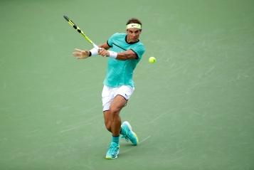 MASON, OH - AUGUST 17: Rafael Nadal of Spain hits a return during his second round match against Pablo Cuevas during day 5 of the Western & Southern Open at the Lindner Family Tennis Center on August 17, 2016 in Mason, Ohio. (Photo by Andy Lyons/Getty Images)