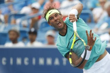 Rafael Nadal, of Spain, serves to Pablo Cuevas, of Uruguay, on the fifth day of the Western & Southern Open tennis tournament, Wednesday, Aug. 17, 2016, in Mason, Ohio. (AP Photo/John Minchillo)