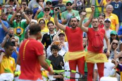 2016 Rio Olympics - Tennis - Preliminary - Men's Singles Third Round - Olympic Tennis Centre - Rio de Janeiro, Brazil - 11/08/2016. Fans of Rafael Nadal (ESP) of Spain react near him after he won his match against Gilles Simon (FRA) of France. REUTERS/Toby Melville TPX IMAGES OF THE DAY. FOR EDITORIAL USE ONLY. NOT FOR SALE FOR MARKETING OR ADVERTISING CAMPAIGNS.