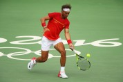 Rafael Nadal of Spain plays a forehand during the men's singles third round match against Gilles Simon of France on Day 6 of the 2016 Rio Olympics at the Olympic Tennis Centre on August 11, 2016 in Rio de Janeiro, Brazil. (Aug. 10, 2016 - Source: Clive Brunskill/Getty Images South America)