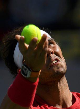 2016 Rio Olympics - Tennis - Preliminary - Men's Singles Third Round - Olympic Tennis Centre - Rio de Janeiro, Brazil - 11/08/2016. Rafael Nadal (ESP) of Spain serves during a warm up session before his match against Gilles Simon (FRA) of France. REUTERS/Toby Melville FOR EDITORIAL USE ONLY. NOT FOR SALE FOR MARKETING OR ADVERTISING CAMPAIGNS.