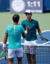 Borna Coric, right, from Croatia, shakes hands with Rafael Nadal, from Spain, after defeating him at the Western & Southern Open tennis tournament, Thursday, Aug. 18, 2016, in Mason, Ohio. (AP Photo/Frank Victores)