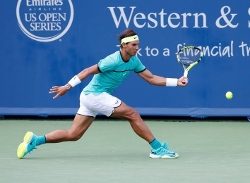 Rafael Nadal, from Spain, returns a serve during a match against Borna Coric, from Croatia, at the Western & Southern Open tennis tournament, Thursday, Aug. 18, 2016, in Mason, Ohio. (AP Photo/Frank Victores)