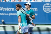 MASON, OH - AUGUST 18: Borna Coric of Croatia hugs Rafael Nadal of Spain following a round three match on Day 6 of the Western & Southern Open at the Lindner Family Tennis Center on August 18, 2016 in Mason, Ohio. Coric defeated Nadal 6-1, 6-3. (Photo by Joe Robbins/Getty Images)