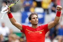 Rafael Nadal of Spain celebrates winning his game against Gilles Simon of France during their men's singles third round match of the Rio 2016 Olympic Games tennis tournament in Rio de Janeiro, Brazil, 11 August 2016. (España, Brasil, Tenis, Francia) EFE/EPA/MICHAEL REYNOLDS