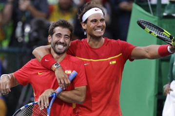 Rafael Nadal, right, and Marc Lopez, of Spain, celebrate after defeating Canada in their men's doubles match at the 2016 Summer Olympics in Rio de Janeiro, Brazil, Thursday, Aug. 11, 2016. (AP Photo/Charles Krupa)