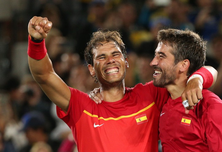 2016 Rio Olympics - Tennis - Final - Men's Doubles Gold Medal Match - Olympic Tennis Centre - Rio de Janeiro, Brazil - 12/08/2016. Rafael Nadal (ESP) of Spain and Marc Lopez (ESP) of Spain celebrate after winning their match against Florin Mergea (ROU) of Romania and Horia Tecau (ROU) of Romania.    REUTERS/Kevin Lamarque  TPX IMAGES OF THE DAY. FOR EDITORIAL USE ONLY. NOT FOR SALE FOR MARKETING OR ADVERTISING CAMPAIGNS.