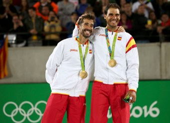 2016 Rio Olympics - Tennis - Victory Ceremony - Men's Doubles Victory Ceremony - Olympic Tennis Centre - Rio de Janeiro, Brazil - 12/08/2016. Rafael Nadal (ESP) of Spain and Marc Lopez (ESP) of Spain react after receiving their gold medals. REUTERS/Kevin Lamarque FOR EDITORIAL USE ONLY. NOT FOR SALE FOR MARKETING OR ADVERTISING CAMPAIGNS.