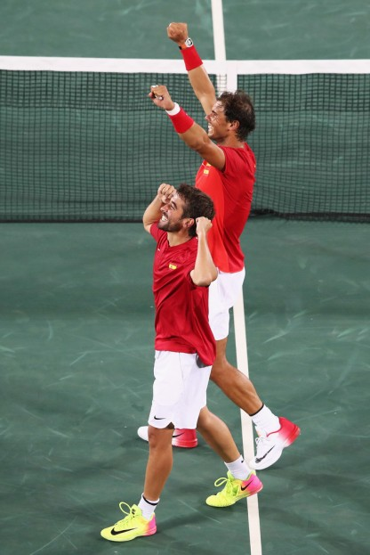 Marc Lopez and Rafael Nadal of Spain celebrate match point during the Men's Doubles Gold medal match against Horia Tecau and Florin Mergea of Romania on Day 7 of the Rio 2016 Olympic Games at the Olympic Tennis Centre on August 12, 2016 in Rio de Janeiro, Brazil. (Aug. 11, 2016 - Source: Mark Kolbe/Getty Images South America)
