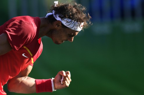 Spain's Rafael Nadal celebrates a point against Japan's Kei Nishikori during their men's singles bronze medal tennis match at the Olympic Tennis Centre of the Rio 2016 Olympic Games in Rio de Janeiro on August 14, 2016. / AFP / JAVIER SORIANO