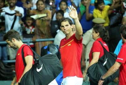 Spain's Marc Lopez (L) and Rafael Nadal (C) leave the court after winning the doubles match of the Tennis Davis Cup World Group Play-Off tie between Spain and India in New Delhi, India, 17 September 2016. (España, Tenis) EFE/EPA/RAJAT GUPTA