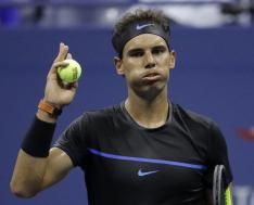 Rafael Nadal, of Spain, challenges a call during a match against Andreas Seppi, of Italy, during the U.S. Open tennis tournament, Wednesday, Aug. 31, 2016, in New York. (AP Photo/Julio Cortez)