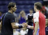 Rafael Nadal, left, of Spain, shakes hands with Andreas Seppi, of Italy, after Nadal's 6-0, 7-5, 6-1 win at the U.S. Open tennis tournament, Wednesday, Aug. 31, 2016, in New York. (AP Photo/Julio Cortez)