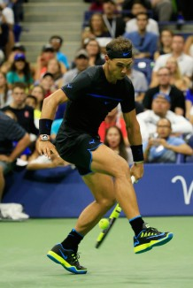 Rafael Nadal of Spain returns a shot by hitting the ball between his legs to Andrey Kuznetsov of Russia during his third round Men's Singles match on Day Five of the 2016 US Open at the USTA Billie Jean King National Tennis Center on September 2, 2016 in the Queens borough of New York City. (Sept. 1, 2016 - Source: Chris Trotman/Getty Images North America)