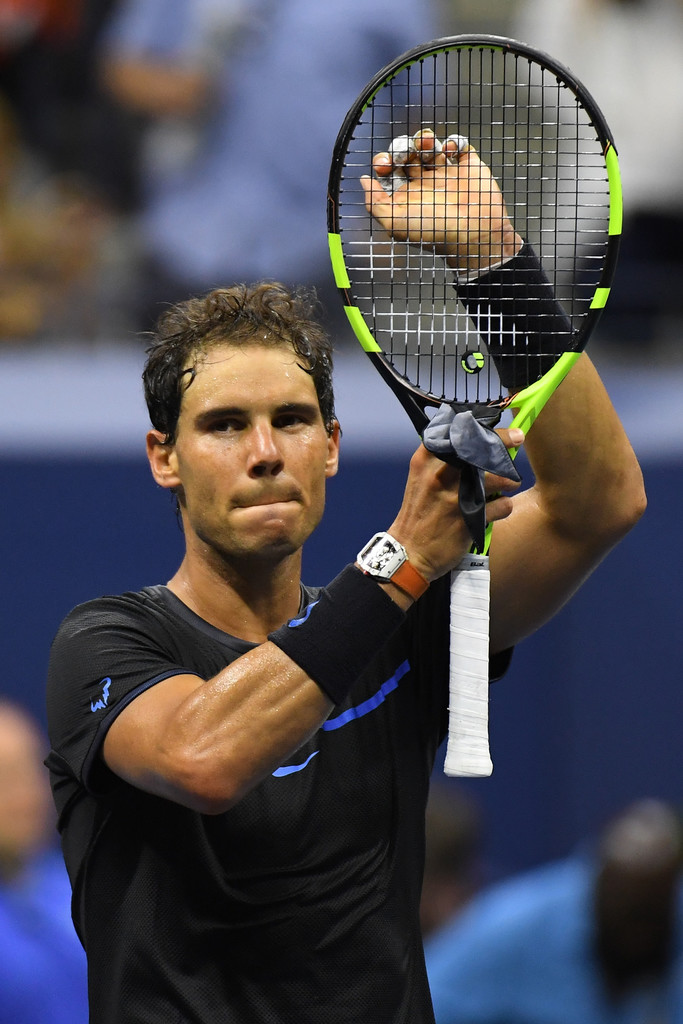 Rafael Nadal of Spain celebrates victory at the end of his Third Round ...