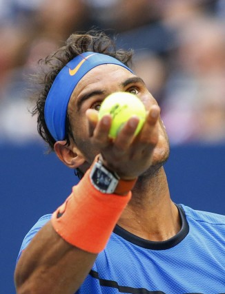 Rafael Nadal of Spain serves against Lucas Pouille of France during their US Open Men's Singles match at the USTA Billie Jean King National Tennis Center in New York on September 4, 2016. / AFP / KENA BETANCUR (Sept. 3, 2016 - Source: AFP)