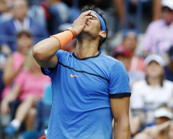 Rafael Nadal, of Spain, reacts during his match with Lucas Pouille, of France, during the fourth round of the U.S. Open tennis tournament, Sunday, Sept. 4, 2016, in New York. (AP Photo/Alex Brandon)