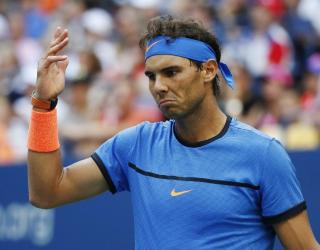 Rafael Nadal, of Spain, gestures during play with Lucas Pouille, of France, during the fourth round of the U.S. Open tennis tournament, Sunday, Sept. 4, 2016, in New York. (AP Photo/Alex Brandon)