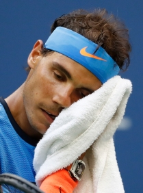 Rafael Nadal, of Spain, wipes his face during play against Lucas Pouille, of France, during the fourth round of the U.S. Open tennis tournament, Sunday, Sept. 4, 2016, in New York. (AP Photo/Alex Brandon)