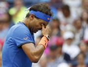 Rafael Nadal, of Spain, rubs his eyes during play against Lucas Pouille, of France, during the fourth round of the U.S. Open tennis tournament, Sunday, Sept. 4, 2016, in New York. (AP Photo/Alex Brandon)