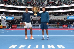 BEIJING, CHINA - OCTOBER 09: Rafael Nadal of Spain and Pablo Carreno Busta of Spain hold the winners trophy after winning the Men's Doubles final against Jack Sock of the United States and Bernard Tomic of Australia on day nine of the 2016 China Open at the China National Tennis Centre on October 9, 2016 in Beijing, China. (Photo by Etienne Oliveau/Getty Images)