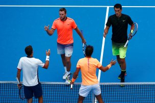 Tennis - China Open men's double final - Beijing, China - 09/10/16. Spain's Pablo Carreno Busta and Rafael Nadal shake hands with Jack Sock of the U.S. and Bernard Tomic of Australia after their match. REUTERS/Thomas Peter