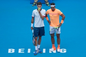 Rafael Nadal, right, and Pablo Carreno Busta of Spain plan their play against Jack Sock of the United States and Bernard Tomic of Australia in the men's doubles final of the China Open tennis tournament at the Diamond Court in Beijing, Sunday, Oct. 9, 2016. (AP Photo/Ng Han Guan)