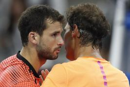 Gregor Dimitrov of Bulgaria, left, hugs Rafael Nadal of Spain after winning the men's singles quarterfinals of the China Open tennis tournament at the Diamond Court in Beijing, Friday, Oct. 7, 2016. (AP Photo/Andy Wong)