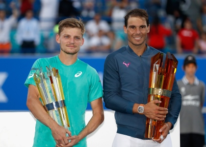 ABU DHABI, UNITED ARAB EMIRATES - DECEMBER 31: (L-R) Runner up David Goffin of Belgium and Champion Rafeal Nadal of Spain pose with their trophies after the Final match of the Mubadala World Tennis Championship at Zayed Sport City on December 31, 2016 in Abu Dhabi, United Arab Emirates. (Photo by Francois Nel/Getty Images)