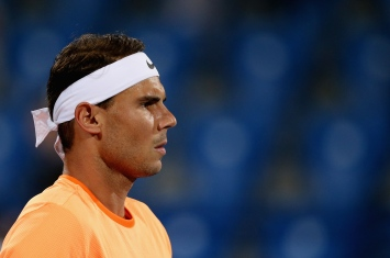 ABU DHABI, UNITED ARAB EMIRATES - DECEMBER 29: Rafael Nadal of Spain looks on during day one of the Mubadala World Tennis Championship at Zayed Sport City on December 29, 2016 in Abu Dhabi, United Arab Emirates. (Photo by Francois Nel/Getty Images)