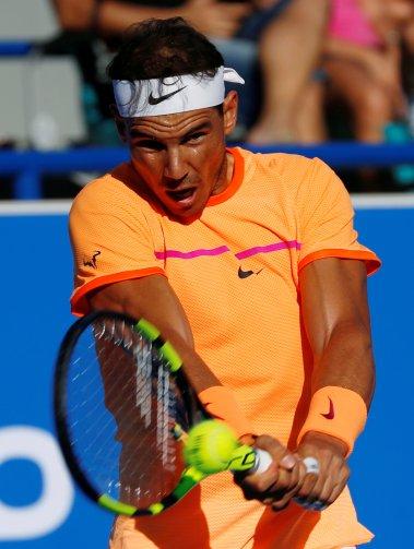 Tennis - Mubadala World Tennis Championship - Rafael Nadal of Spain v David Goffin of Belgium- Abu Dhabi, UAE - 31/12/16. Rafael Nadal of Spain in action. REUTERS/Ahmed Jadallah