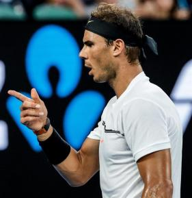 Rafael Nadal of Spain in action against Roger Federer of Switzerland during their Men's Singles final match at the Australian Open Grand Slam tennis tournament in Melbourne, Victoria, Australia, 29 January 2017. (España, Abierto, Tenis, Suiza) EFE/EPA/MADE NAGI