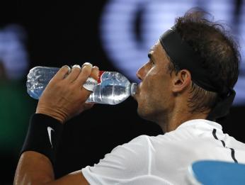 Spain's Rafael Nadal takes a drink during a break in his men's singles final against Switzerland's Roger Federer at the Australian Open tennis championships in Melbourne, Australia, Sunday, Jan. 29, 2017. (AP Photo/Dita Alangkara)