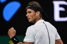 Spain's Rafael Nadal reacts after a point against Switzerland's Roger Federer during the men's singles final on day 14 of the Australian Open tennis tournament in Melbourne on January 29, 2017. / AFP / GREG WOOD