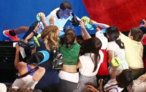Rafael Nadal of Spain signs autographs for supporters in the crowd after winning his fourth round match against Gael Monfils of France on day eight of the 2017 Australian Open at Melbourne Park on January 23, 2017 in Melbourne, Australia. (Jan. 22, 2017 - Source: Scott Barbour/Getty Images AsiaPac)