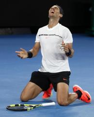 Spain's Rafael Nadal celebrates after defeating Bulgaria's Grigor Dimitrov during their semifinal at the Australian Open tennis championships in Melbourne, Australia, early Saturday, Jan. 28, 2017. (AP Photo/Dita Alangkara)