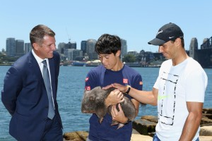 Kei Nishikori and Rafael Nadal pose with Lola the wombat ahead of the Fast4International Exhibition this evening at the ICC Sydney Theatre on January 9, 2017 in Sydney, Australia. (Jan. 8, 2017 - Source: Jason McCawley/Getty Images AsiaPac)